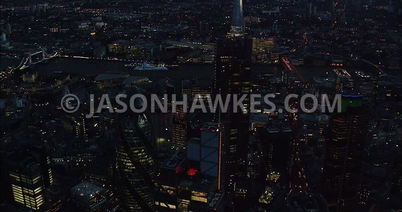 London Aerial Footage of City of London financial district close up at night.