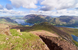Views of Lake Buttermere and Crummock Water on route to the summit of Red Pike with Wandope, Whiteless Pike, Grasmoor and Robinson in the distance. The English Lake District, UK.