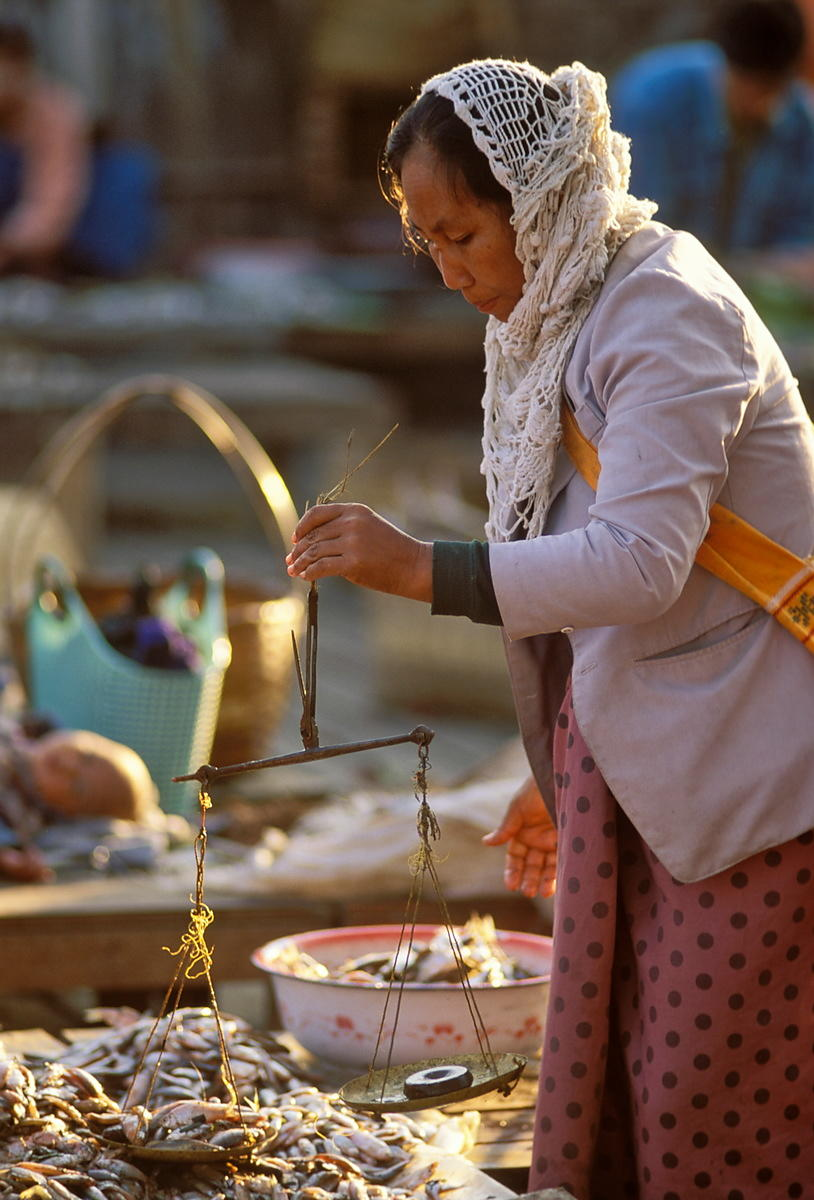 Woman weighing fish