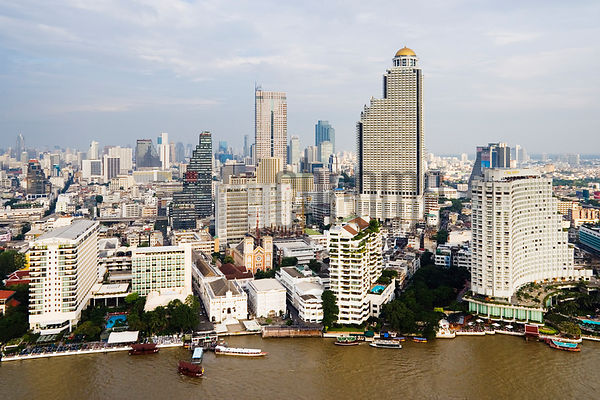 Thailand, Bangkok skyline and River Chao Phraya, elevated view