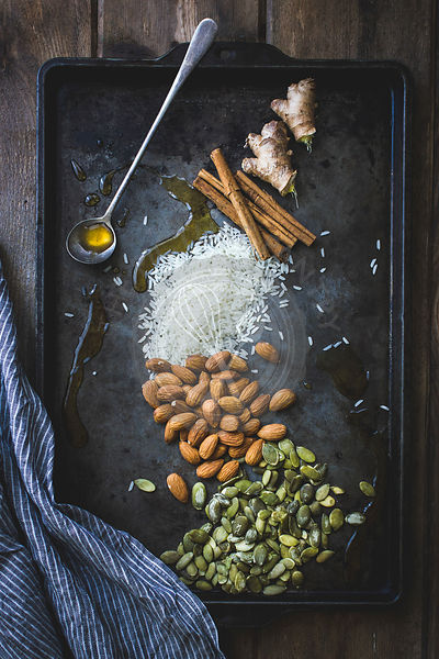 Spices, nuts and seeds on a baking tray