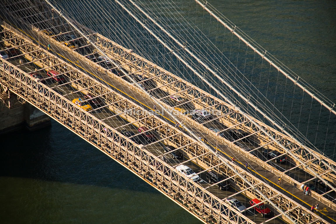 On the day the Brooklyn Bridge was dedicated in 1883, 150,000 people crossed the bridge.  Manhattan, New York City.