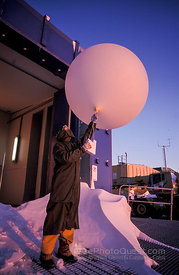 Antarctic Expeditioner Launching Meteorological Balloon