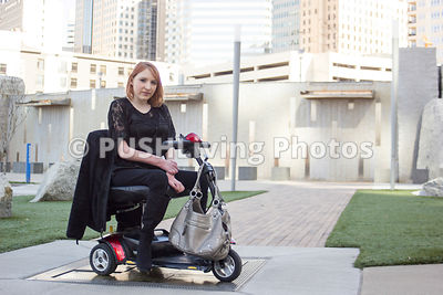 Woman exploring a city on her mobility scooter