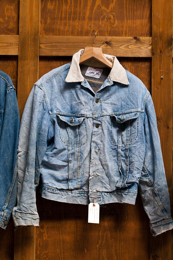 UK - London - An antique denim jacket on a rack  in the vintage clothes shop Blitz on Hanbury Street. Spitalfields.
