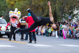 A member of the Vietnam Student Association during the  University of Iowa homecoming Parade on Clinton St in Iowa City on Fr...