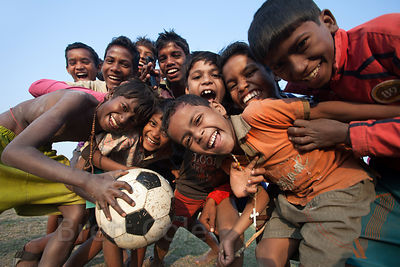 Kids play soccer in a village near the rural town of Bantala, Kolkata, India.