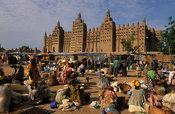 Djenné mosque on market day, the largest mud structure in the world was first built in 1907, Djenné, Mali