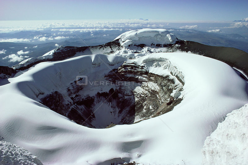 Aerial view of Cotopaxi volcano crater in snow, Ecuador