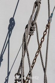 Fishing Boat Rope and Chain Against White Hull in Newport, Oregon