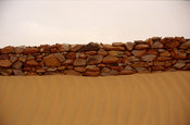 A wall almost buried by the sand and the wind, Chinguetti