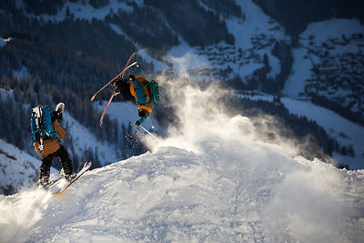 Etienne Merel catching Candide's handrag 360 next to a slope in la Clusaz