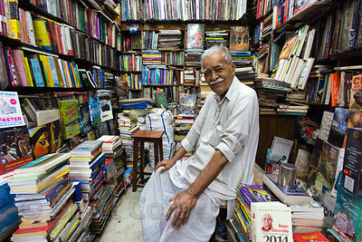 Bookseller and his wonderfully crowded shop, Newmarket, Kolkata, India