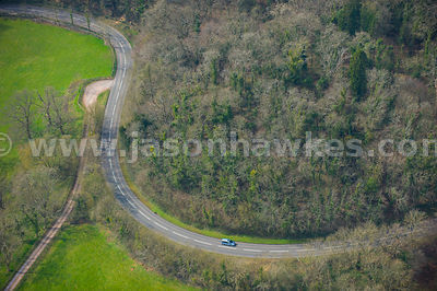 Aerial view of car driving through countryside, Somerset
