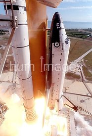 A close-up camera view shows Space Shuttle Columbia as it lifts off from Launch Pad 39A on mission STS-107.