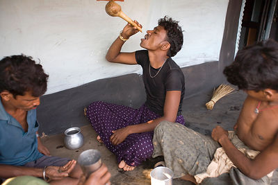 Tribal villagers drink toddy
