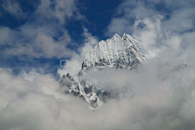 NEPAL Mount Thamserku -- Sep 2007 -- Cloudy, but beautiful...Mount Thamserku (6608m) is featured in this image.