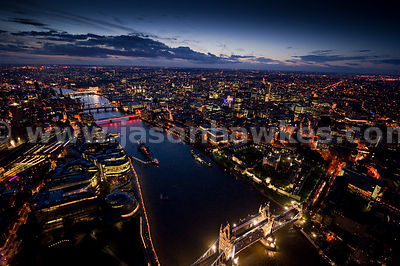Aerial view over River Thames at night, London