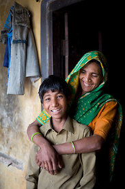 Anuj Kumar, 10 at home with his mother, Chandra