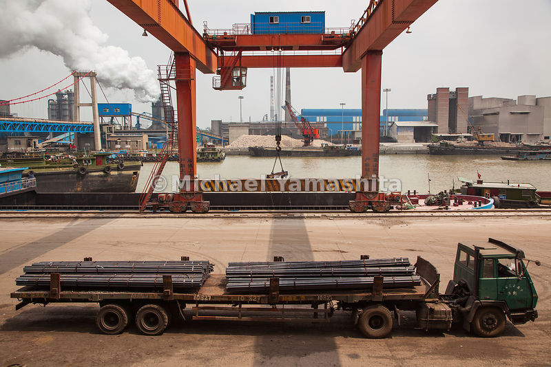 Steel rods on a flatbed at Huaigang Steel in Huaian will be loaded onto barges for shipment on the Grand Canal. The waterway ...