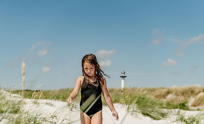 Girl on the beach by Dueodde Lighthouse