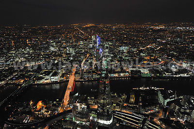 Night aerial view of the Shard looking North to the City of London