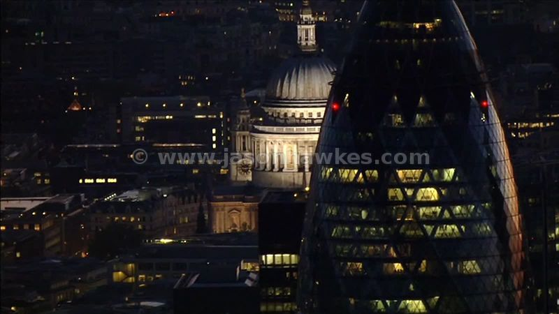 Aerial footage around the City of London an St Paul's at night, London, England, UK