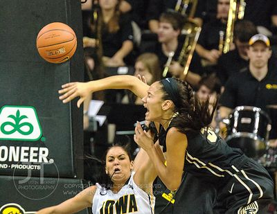 Iowa's Claire Till (3) fouls Purdue's Whiteny Bays (32) during the second half of play at Carver-Hawkeye Arena in Iowa City o...
