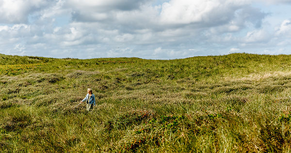 Danish girl playing in the dunes in Thy 14