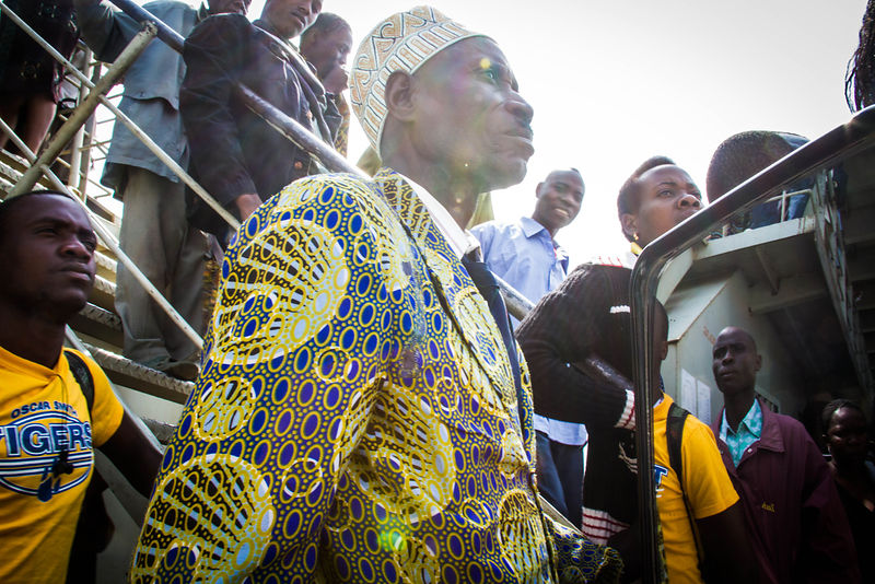 Man in Kitenge jacket on a ferry on Lake Victoria, northern Tanzania.