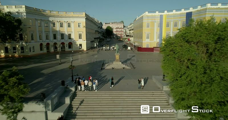 Aerial drone camera flies backward and climbs from the Duc Richelieu statue in Odessa Ukraine to reveal the newly refurbished...