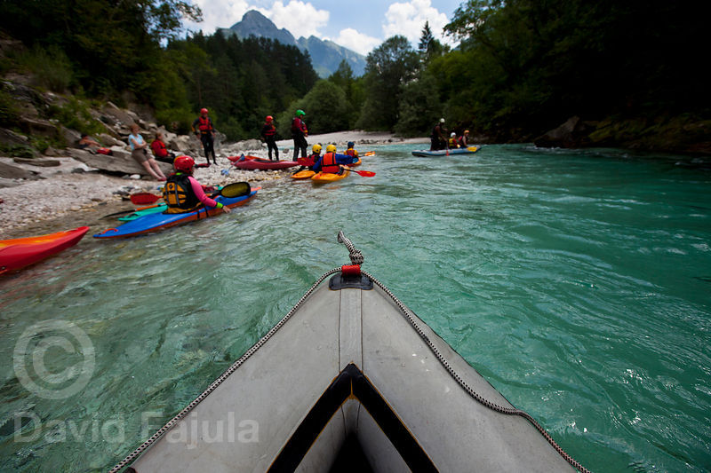 Kayaks and mini-rafts in the Soča river shore