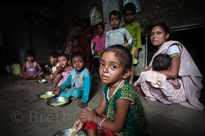 Children eat in a group in a slum area in Taratala, Kolkata, India, in an area served by PATH Welfare Society. Malnutrition i...