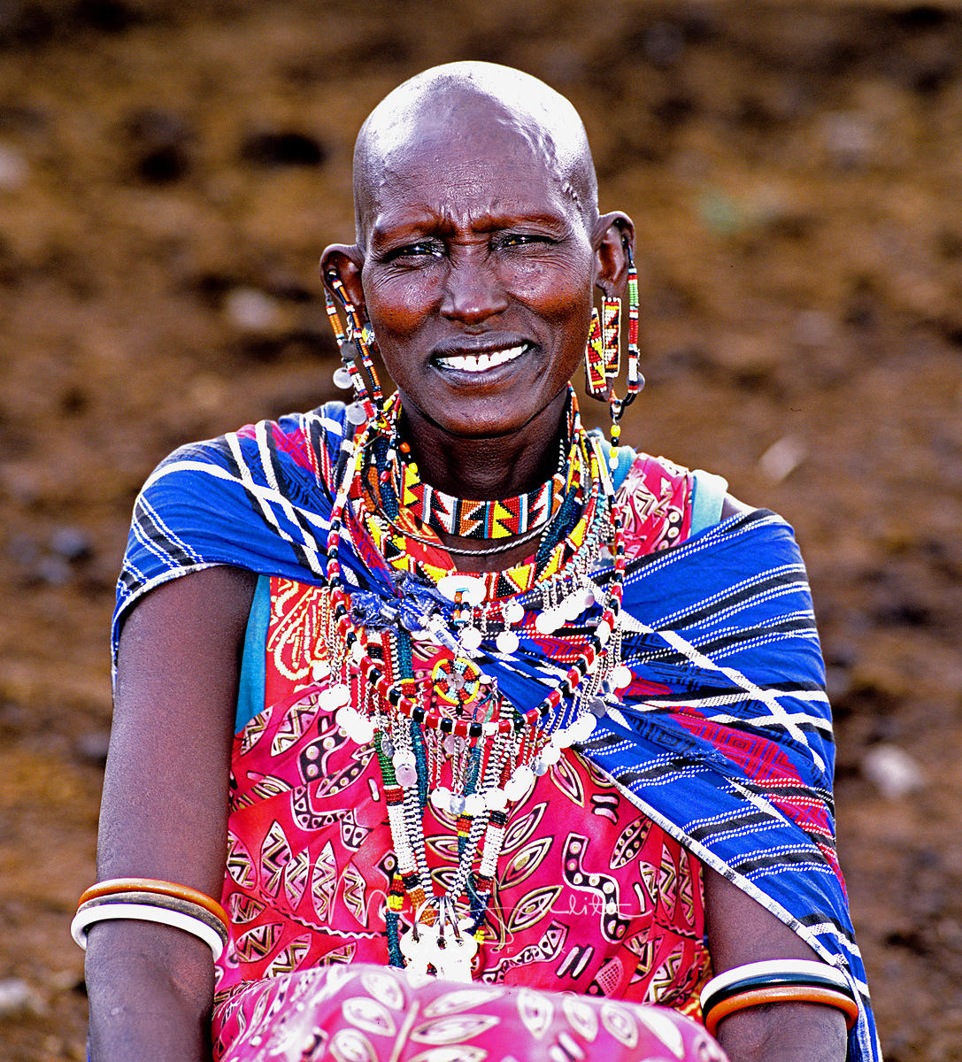 Africa_Woman_ear_hole_sitting_cropped_tweeked