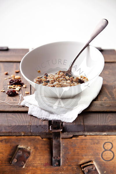 Healthy breakfast with muesli on textured background