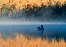 Fishing in foggy lake