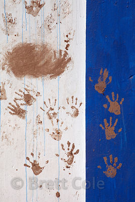 Handprints on a wall in a depressed industrial area near Science City, Kolkata, India.