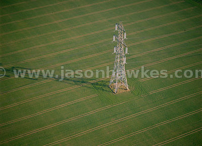 Electricity pylon in field