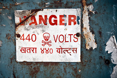 Sign reading Danger 440 Volts in Jaipur, Rajasthan, India