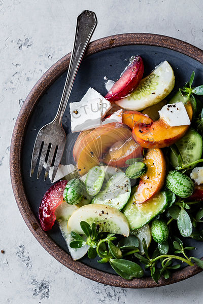 Cucamelons, peaches, cucumber, ricotta cheese and purslane salad.