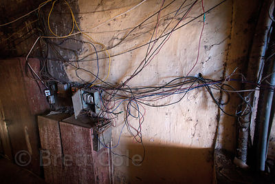 Tangle of wires in an apartment building, Lalbaug, Mumbai, India.