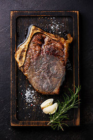 Grilled meat barbecue steak Blade on bone on dark background