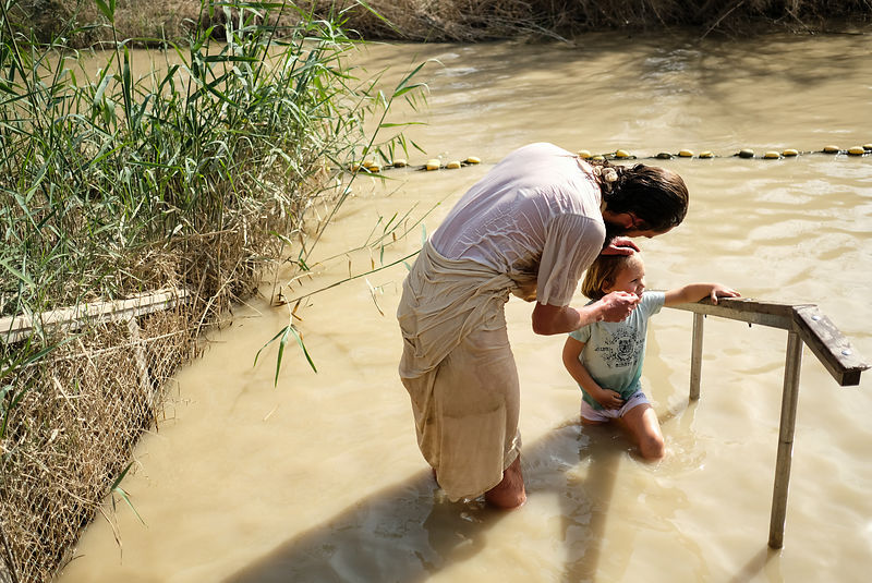 Orthodox Christian pilgrims participate in the traditional Epiphany baptism ceremony at the Jordan river at the site of Qasr ...