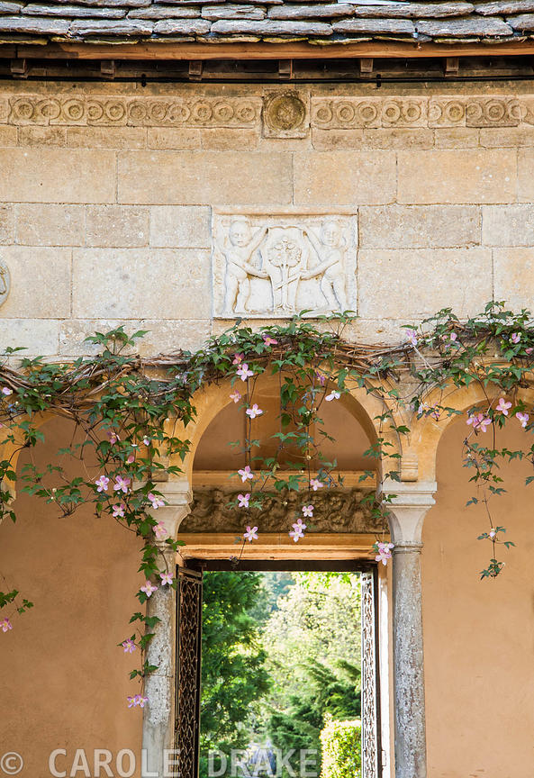 Relief sculpture above Clematis montana in inner court of Cloisters. Iford Manor, Bradford-on-Avon, Wiltshire