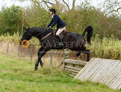 Ida Thore jumping a hunt jump near Peake's. The Cottesmore Hunt at Somerby