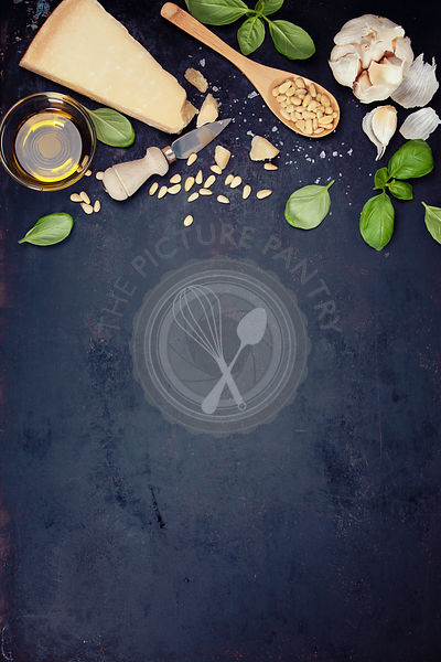 Ingredients for italian pesto sauce on rustic background