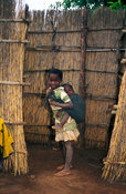 girl carrying her baby brother at her homestead, Lichinga, Niassa province, Mozambique