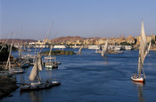 Aswan at the Nile seen from Elephantine island, with feluccas on the river, Aswan, Egypt