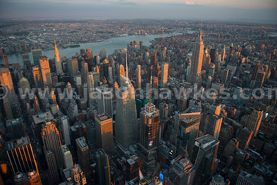 Aerial view looking across Midtown Manhattan, showing the Empire State Building, the Chrysler Building and the Bank of Americ...