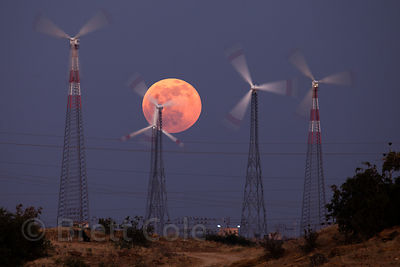 Full moon rising over windmills in the Thar Desert near Jaisalmer, Rajasthan, India